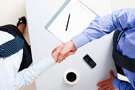 Lawyer and a Client Shaking Hands