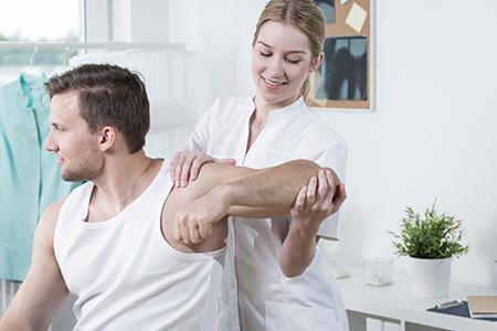 A Woman Massaging Her Husband's Injured Arm